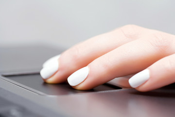 Female hand using laptop