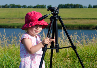 Little Photographer with Professional Tripod, River Background,