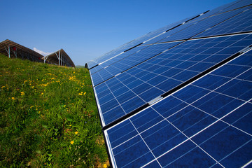 Solar panels and blue sky and green grass