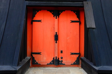 Red door on temple - Japan