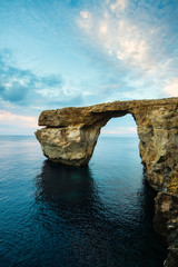 Azure Window, natural arch on Gozo island, with dramatic sky