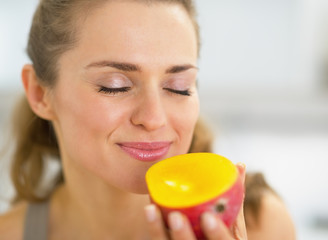 Young woman enjoying mango