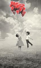Niños con Globos Corazón