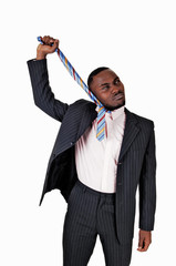 Black man pulling his tie.