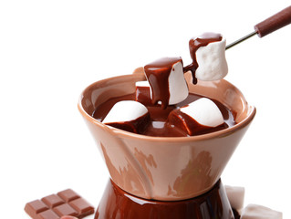 Chocolate fondue with marshmallow candies, isolated on white