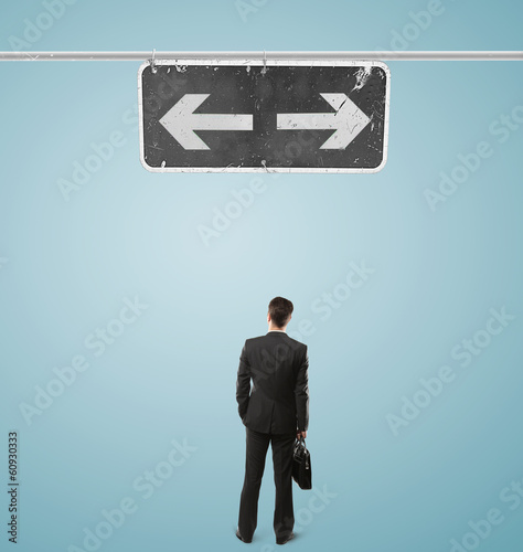 businessman looking at pointer
