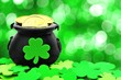 St Patricks Day Pot of Gold and shamrocks over green