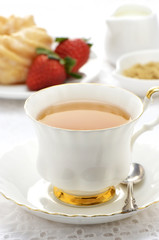 Tea  with cruller and strawberries