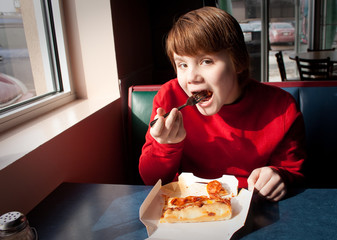 Child eating Pizza