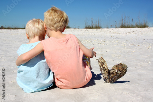 Brothers Sitting Together on Beach
