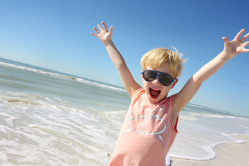 Super Happy Little Boy on Beach