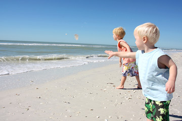 Children Throwing Seashells into the Ocean