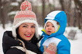 Happy mother and baby boy in winter