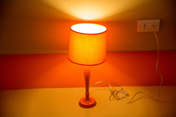 orange lamp on table