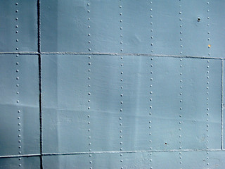Detailed gray metal historic ship wall with seams and rivets. wi
