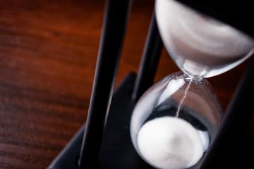 Sand running through an hour glass
