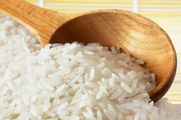 Rice on wooden spoon
