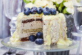 White chocolate cake decorated with blueberries