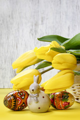 Beautiful yellow tulips, easter eggs and ceramic rabbit - spring