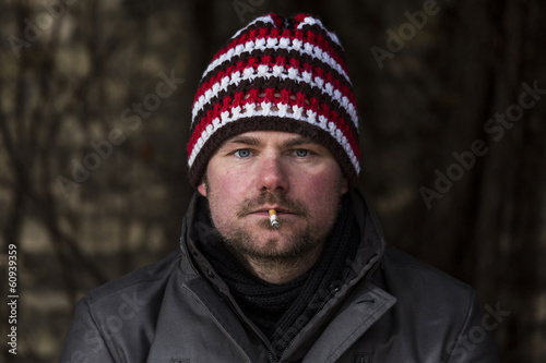 smoker sitting outside in the cold