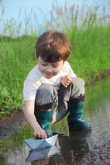 little boy play in water