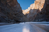 Trekker walking on the frozen Zanskar River in Ladakh.