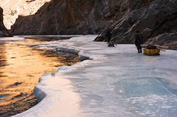 Reflection of sunlight on the frozen Zanskar river, Chadar Trek