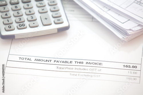 Business document of tax invoice form with calculator