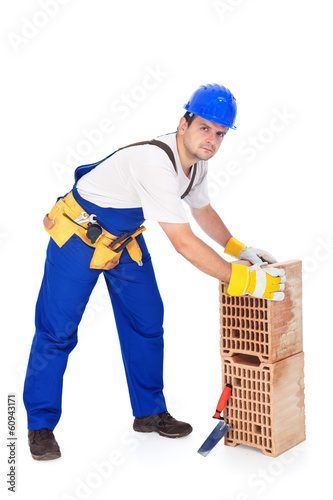 Construction worker with ceramic bricks