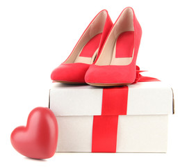 Beautiful red female shoes, heart and gift box, isolated