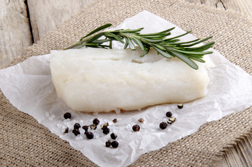 cod with rosemary on kitchen paper