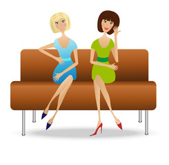 two young woman  sit on sofa