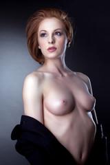 Portrait of beautiful woman posing topless