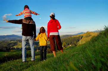 Happy family on vacation in mountains, hiking