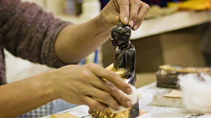 Gilded statues of Buddha in the workshop