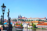 View on the Prague gothic Castle and Charles Bridge above River