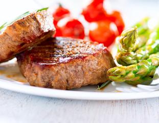 Steaks. Grilled Beef Steak Meat with Vegetables
