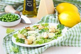 Fresh spring salad with lettuce, eggs, cheese, croutons, pea