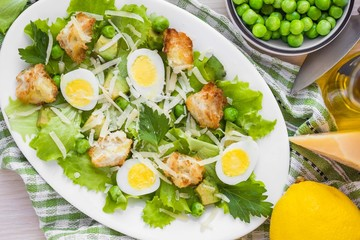 Fresh summer salad with lettuce, eggs, cheese, croutons, green