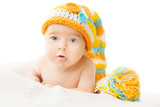Baby hat newborn portrait in woolen cap over white background