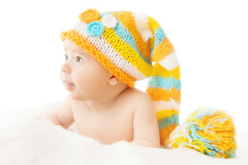 Newborn hat baby portrait in woolen cap over white background