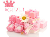 pink baby boots, pacifier, gifts and flower isolated on white