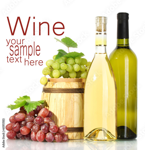 barrel and bottles of wine and ripe grapes isolated on white