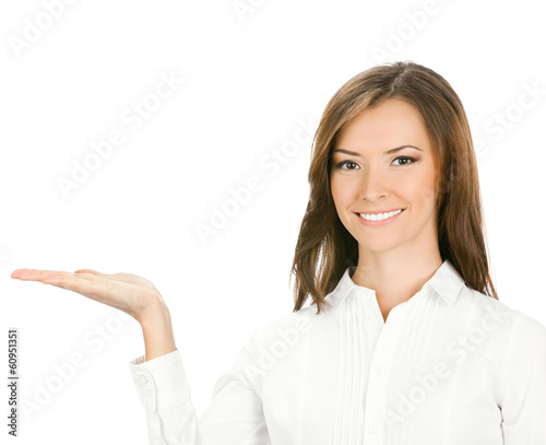 Businesswoman showing something or holding, over white