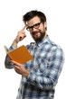 Young Man Reading Book and Gesturing