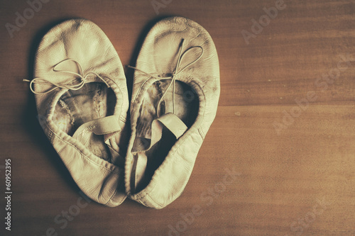 A worn out pair of children's ballet shoes