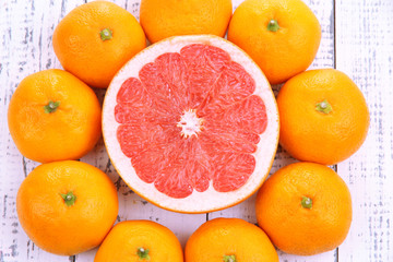 Ripe sweet tangerines on color wooden background