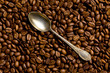 silver spoon on coffee beans
