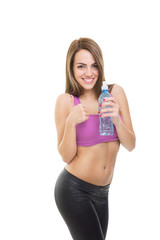 Attractive positive fitness woman holding water bottle