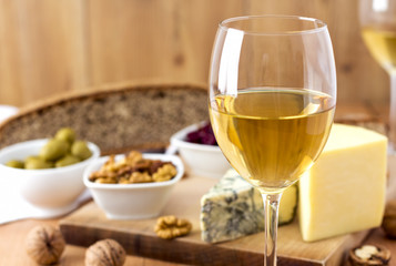White Wine and cheese arrangement on the table